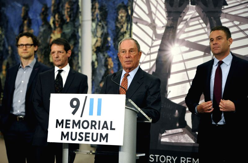 Michael Bloomberg (2nd R), Chairman of the 9/11 Memorial Museum and Mayor of New York City from 2002-2013 delivers a speech during a preview of the National ...