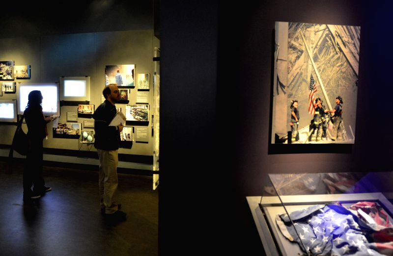 People view exhibits during a preview of the National September 11 Memorial Museum in New York, May 14, 2014. The National September 11 Memorial Museum will serve ..