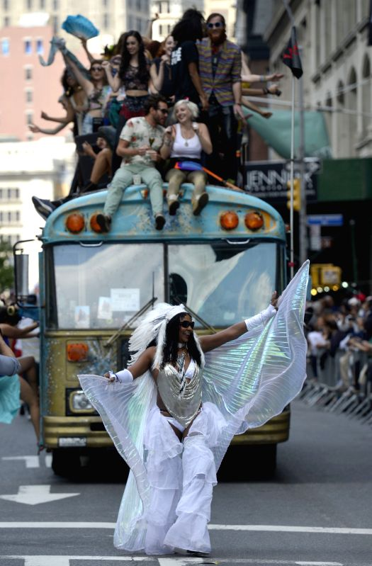Dancers perform as they take part in the annual dance parade in New York City, the United States, on May 17, 2014. Thousands of dancers came to Broadway in ...