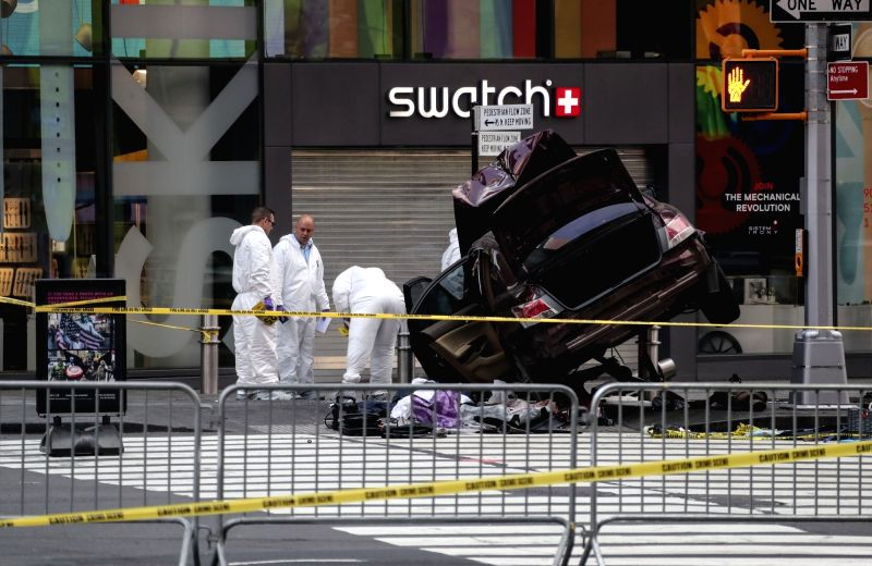 NEW YORK, May 18, 2017 - Investigators work on the scene of a car crash incident at Times Square in New York City, the United States, on May 18, 2017. The man who drove a car into a crowd in Times ...