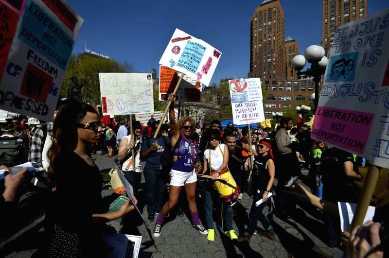 Protestors from Occupy Wall Street and other organizations hold a protest demanding better payment and more immigration rights on May Day in Manhattan, New York, the