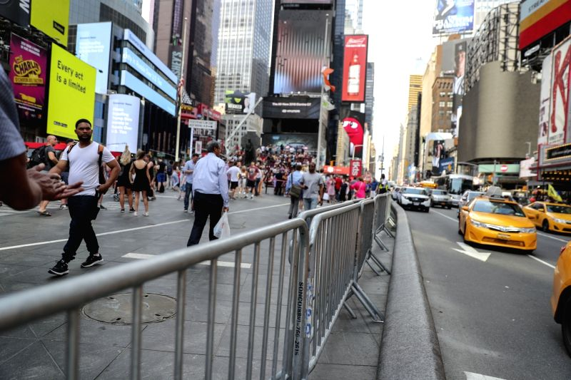 NEW YORK, May 20, 2017 - Fences are set up between the sidewalk and vehicle road at the Times Square in New York, the United States, May 19, 2017. Security was tightened here on Friday after a car ...
