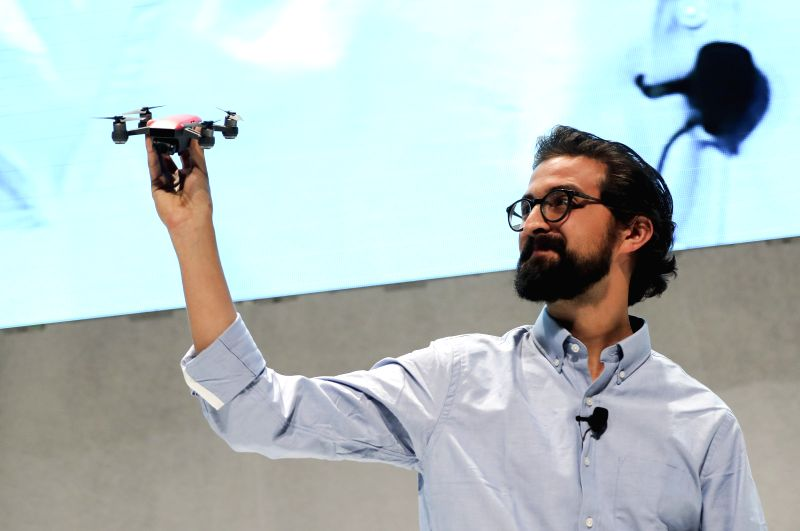 "NEW YORK, May 24, 2017 - Michael Perry, director of strategic partnerships of DJI, demonstrates the palm-sized drone ""Spark"" during an event in New York, the United States, on May 24, 2017. ..."