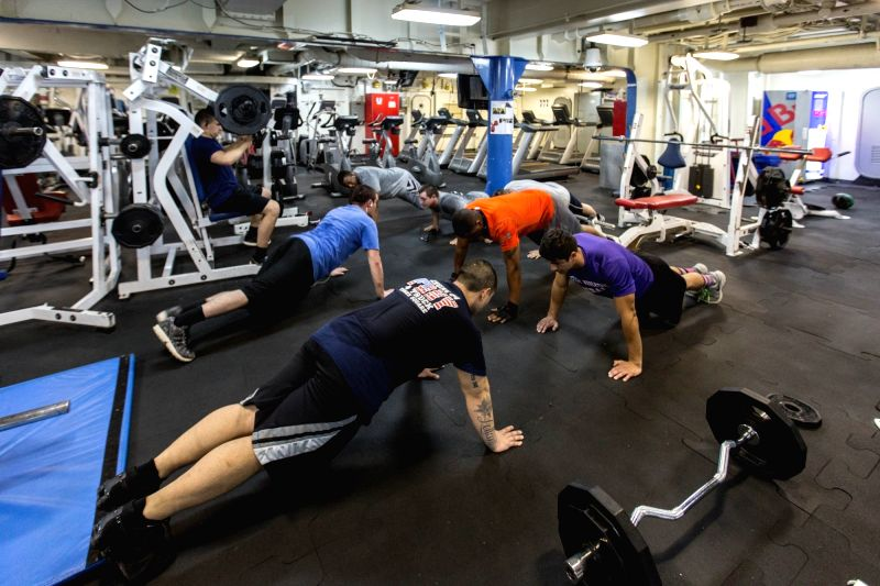 NEW YORK, May 27, 2016 - Soldiers work out in the gym on board the USS Bataan (LHD-5), Wasp-class amphibious assault ship, during the 28th Annual New York Fleet Week in New York, the United States on ...