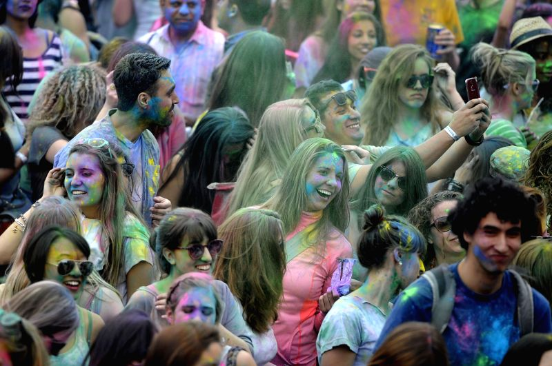 People participate in the Festival of Colors: Holi NYC in New York, the United States, May 3, 2014. The festival is a joyous celebration of the coming of spring. It .