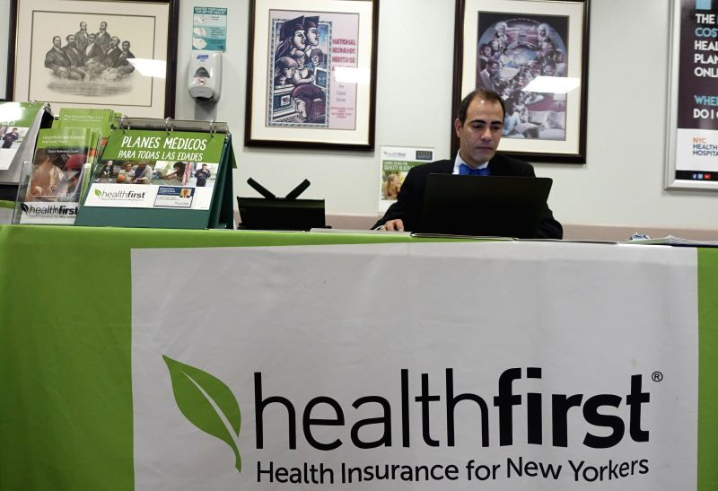 NEW YORK, May 4, 2017 - A staff member works at a health insurance counter at a hospital in New York, the United States on May 3, 2017. U.S. Republican-controlled House of Representatives on Thursday ...