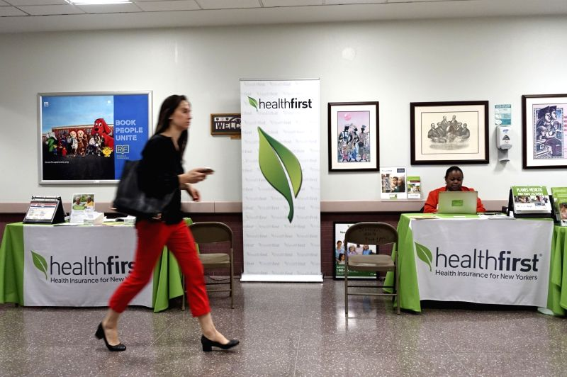 NEW YORK, May 4, 2017 - A woman walks past an health insurance counter at a hospital in New York, the United States on May 3, 2017. U.S. Republican-controlled House of Representatives on Thursday ...