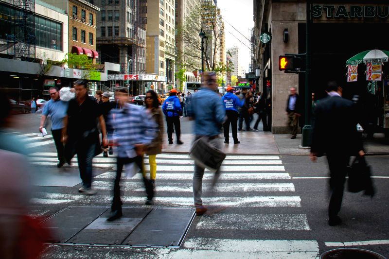 Pedestrians walk across the street when they are not supposed to in New York City's Manhattan, on May 7, 2014. There are 40 pedestrians hit and killed by cars in the