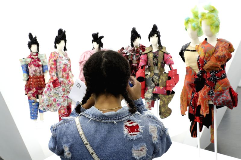 NEW YORK, May 9, 2017 - A visitor takes photos of the works designed by Rei Kawakubo at Costume Institute's spring 2017 exhibition in Metropolitan Museum of Art in New York, the United States, on May ...
