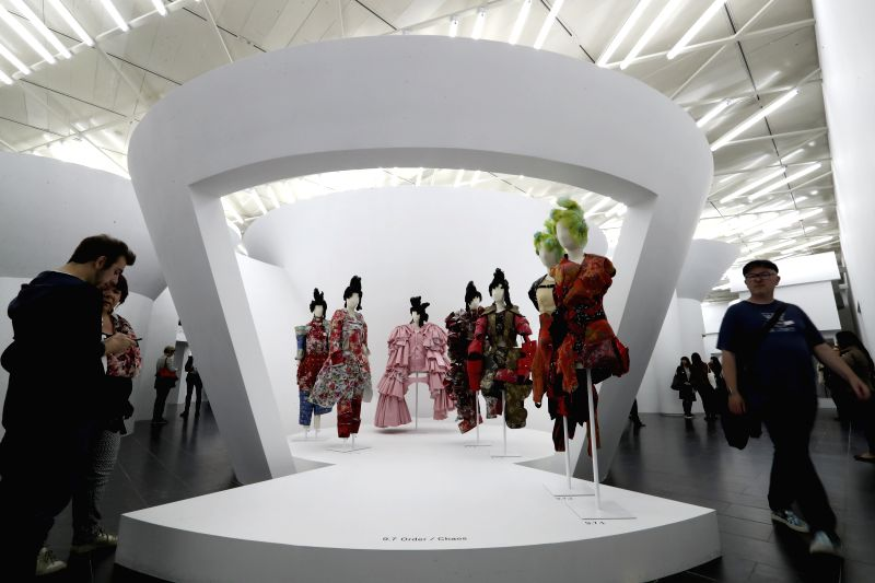 NEW YORK, May 9, 2017 - People look at the works designed by Rei Kawakubo at Costume Institute's spring 2017 exhibition in Metropolitan Museum of Art in New York, the United States, on May 9, 2017. ...