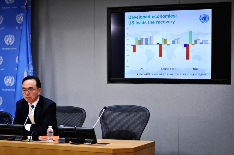 New York: Pingfan Hong, Director of the Development and Policy Analysis Division for the UN Department of Economic and Social Affairs, speaks during a press conference to preview the World Economic ..