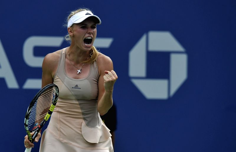 Caroline Wozniacki of Denmark reacts during the women's singles fourth round match against Maria Sharapova of Russia at the 2014 U.S. Open in New York, the United .