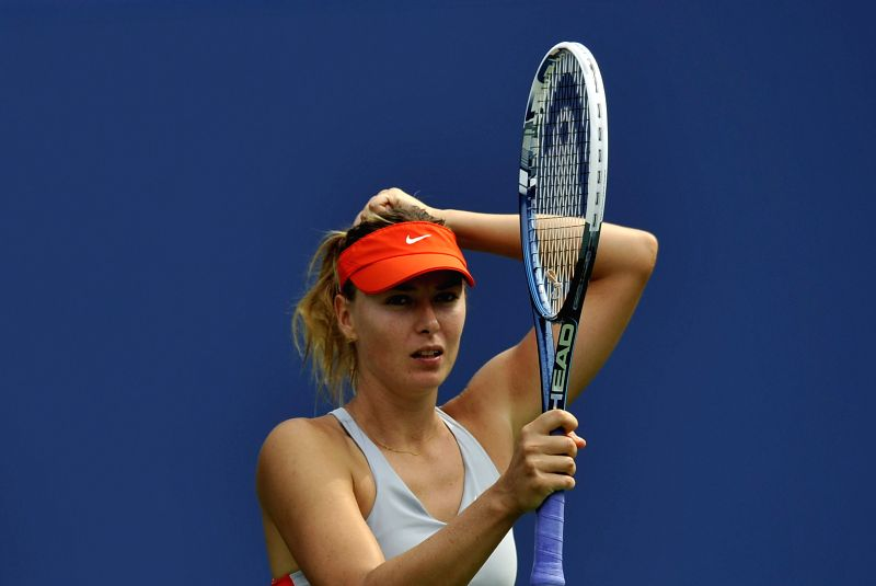 Maria Sharapova of Russia reacts during the women's singles fourth round match against Caroline Wozniacki of Denmark at the 2014 U.S. Open in New York, the United .