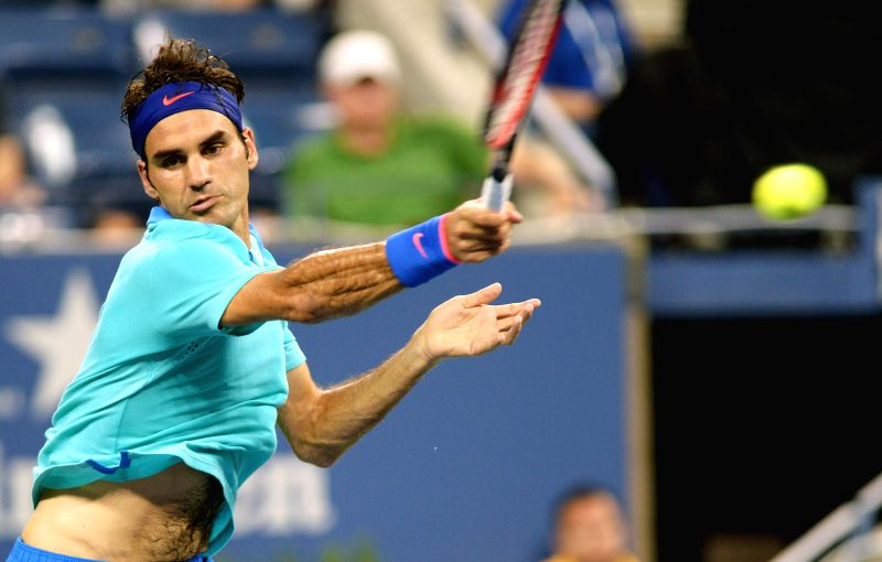 Roger Federer of Switzerland returns a shot against Marcel Granollers of Spain during their men's singles third round match at the 2014 U.S. Open in New York, the .