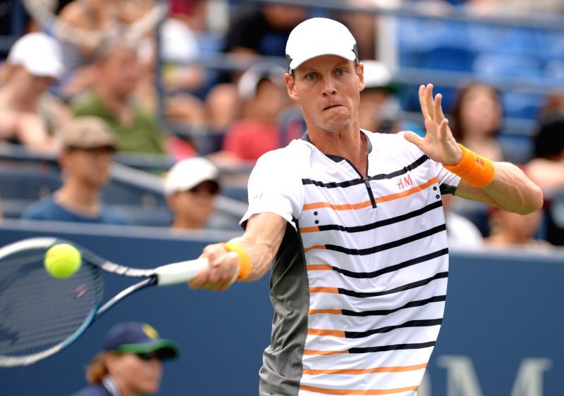 Tomas Berdych of the Czech Republic returns a shot to Teymuraz Gabashvili of Russia during their men's singles third round match at the 2014 U.S. Open in New York,