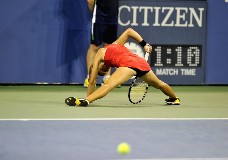 Aleksandra Krunic of Serbia competes during the women's single 4th round match against Victoria Azarenka of Belarus at the 2014 U.S. Open in New York, the United ..