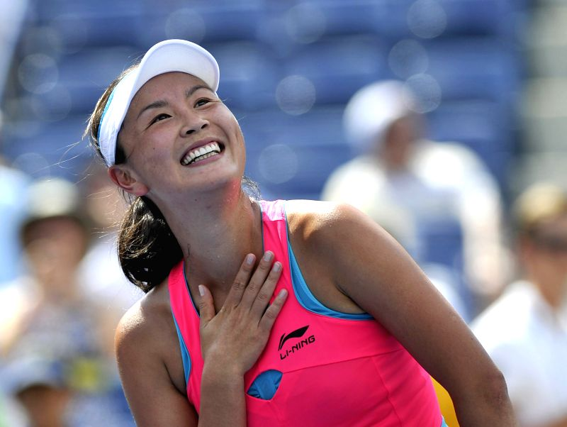 Peng Shuai of China reacts after the women's singles quarterfinal match against Belinda Bencic of Switzerland at the 2014 U.S. Open in New York, the United States,