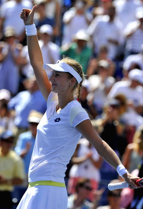 Ekaterina Makarova of Russia celebrates after winning the women's singles quarterfinal match against Victoria Azarenka of Belarus at the 2014 U.S. Open in New ...