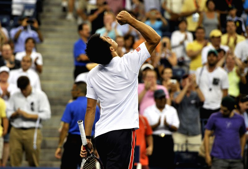 Kei Nishikori of Japan celebrates after winning the Men's Singles Quarterfinals match against Wawrinka of Switzerland at the 2014 U.S. Open in New York, the United