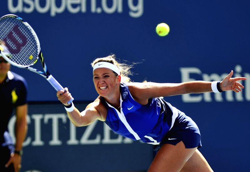 Victoria Azarenka of Belarus returns a shot during the women's singles quarterfinal match against Ekaterina Makarova of Russia at the 2014 U.S. Open in New York, ..