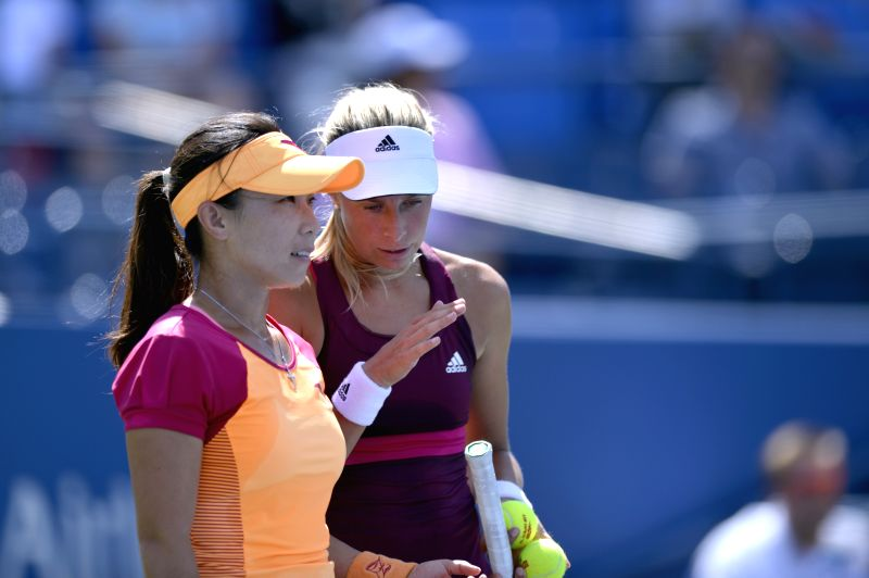 Zheng Jie (L) of China and Andrea Hlavackova of the Czech Republic talk during their women's doubles quarterfinal match against Kimiko Date-Krumm of Japan and ...