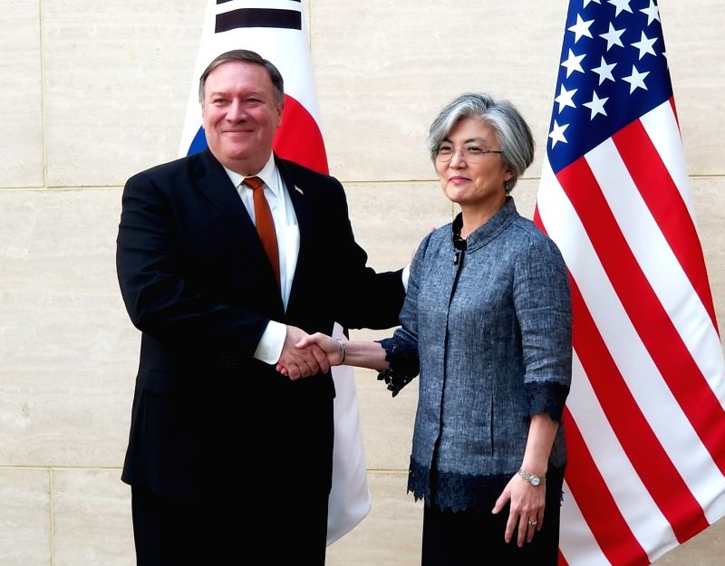 New York: South Korean Foreign Minister Kang Kyung-wha (R) shakes hands with U.S. Secretary of State Mike Pompeo during their meeting at the South Korean mission to the U.N. in New York on July 20, ... - Kang Kyung