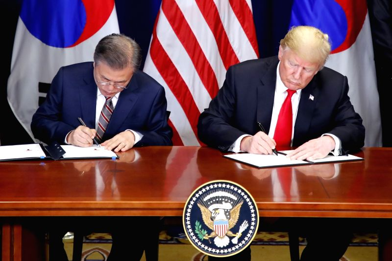 New York: Moon, Trump sign revised trade pact