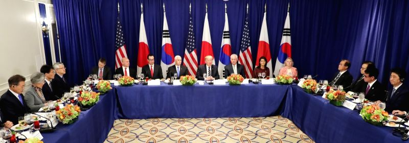 New York: South Korean President Moon Jae-in (L), U.S. President Donald Trump (4th from R, back row) and Japanese Prime Minister Shinzo Abe (R), as well as officials from the three countries hold a ... - Shinzo Abe
