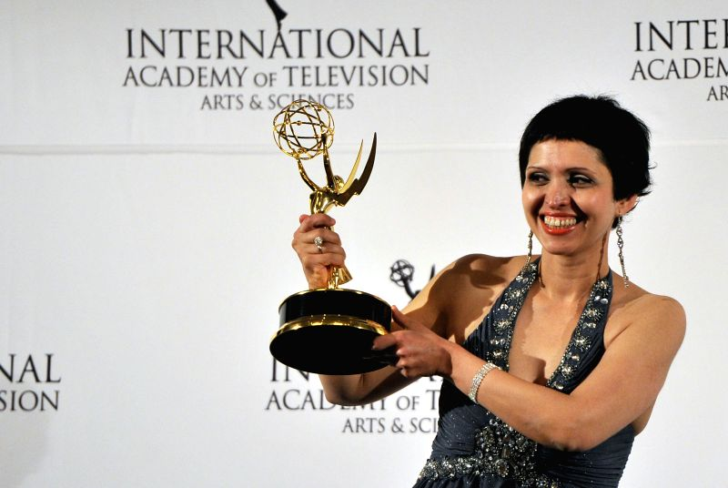 "New York: Swedish producer Maryam Ebrahimi poses for a photo with the ""Documentary"" award during the 42nd International Emmy Awards in New York, the United States, Nov. 24, 2014. ..."