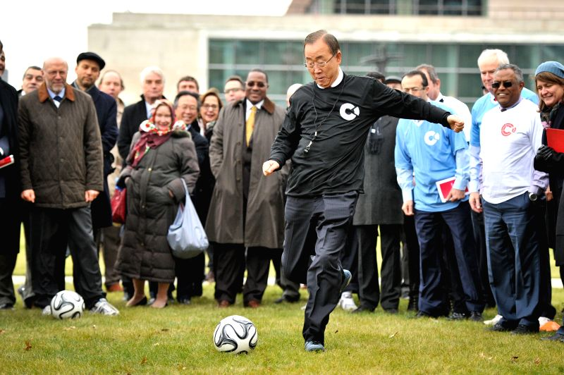 "New York: UN Secretary General Ban Ki-moon (C) participates in an informal football penalty shoot-out during an event commemorating the centenary of World War I ""Christmas Truce"", at the UN"