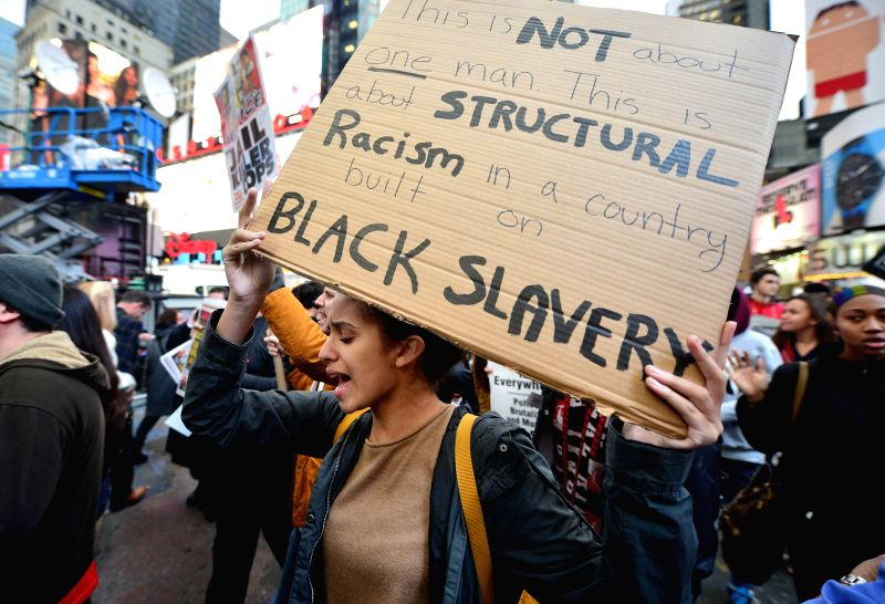 New York (United States): People take part in a protest in New York, the United States, on Dec. 1, 2014. Demonstrations continue over a grand jury's decision last week not to charge police officer ...