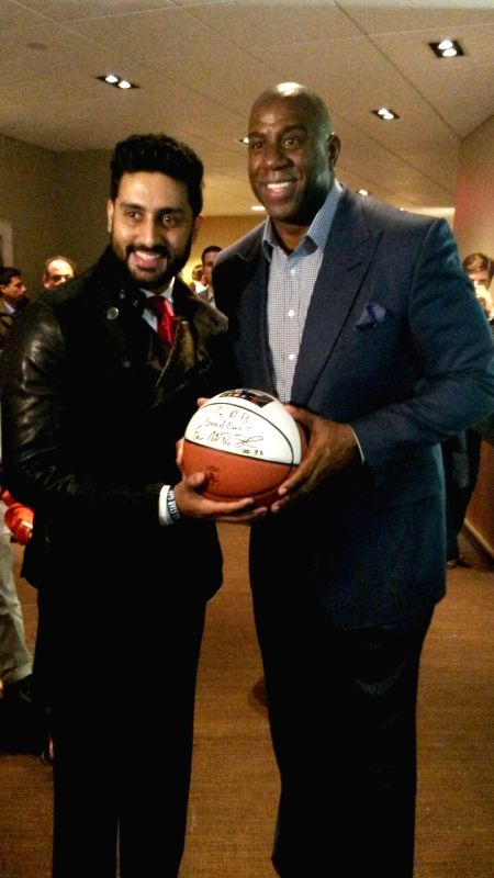 New York (US): Actor Abhishek Bachchan with retired American professional basketball player Magic Johnson during NBA All-Star Weekend in New York city as shared by the actor on his Twitter account. - Abhishek Bachchan