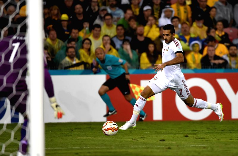 Ali Mabkhout of United Arab Emirates dribbles the ball during the semifinal match against Australia at the 2015 AFC Asian Cup in Newcastle, Australia, Jan. 27, ...