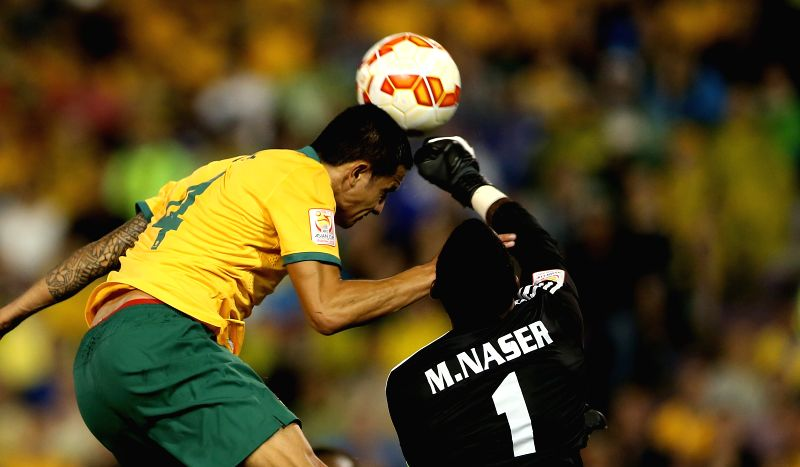 Tim Cahill (L) of Australia competes with the goalkeeper Majed Naser of United Arab Emirates during their semifinal match at the 2015 AFC Asian Cup in Newcastle, .