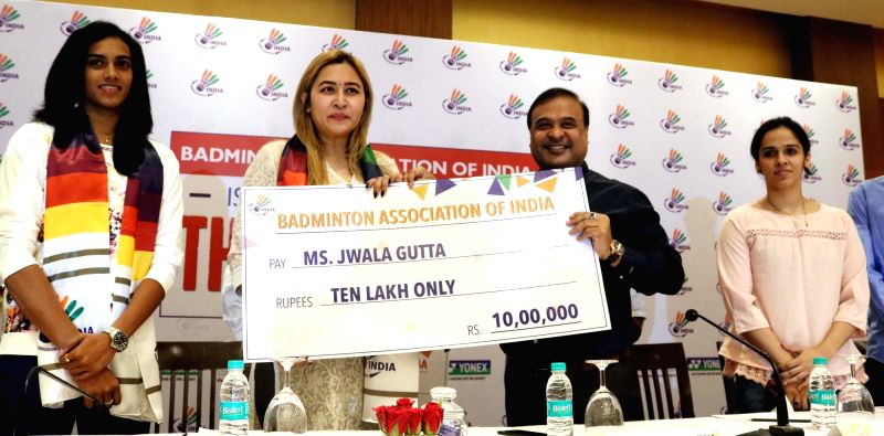 Newly-appointed Badminton Association of India president Dr. Himanta Biswa Sarma presents a cheque of Rs 10 lakh to Indian badminton player Jwala Gutta during a programme in New Delhi, on ...
