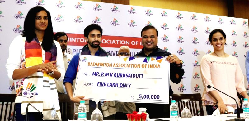 Newly-appointed Badminton Association of India president Dr. Himanta Biswa Sarma presents a cheque of Rs. five lakh to Indian badminton player Gurusai Dutt during a programme in New Delhi, ... - Gurusai Dutt
