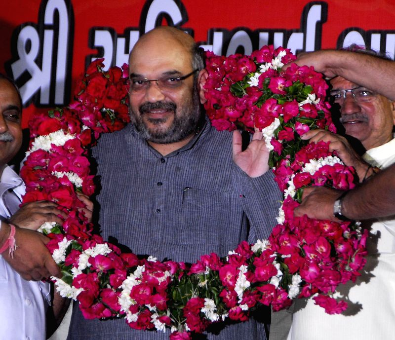 Newly appointed BJP chief Amit Shah being felicitated by party workers during a programme organised in Ahmedabad on July 11, 2014.