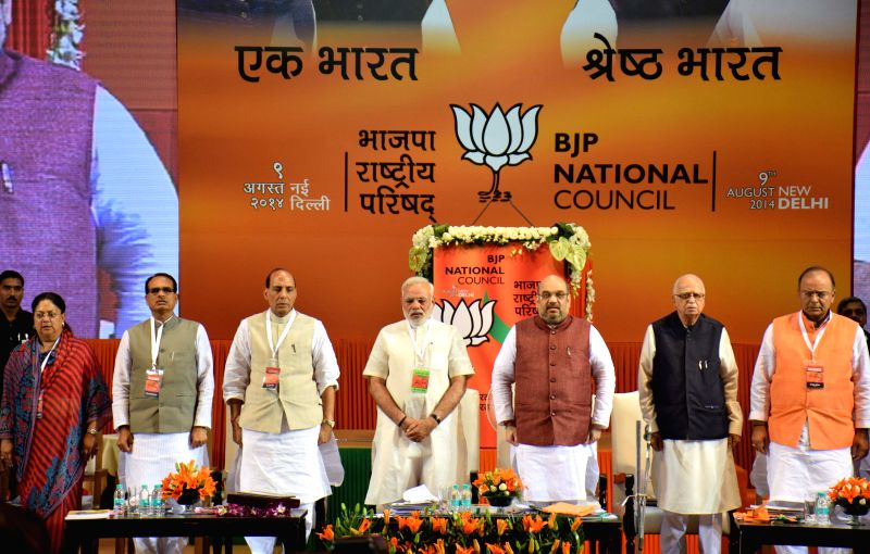 Newly appointed BJP President Amit Shah, Prime Minister Narendra Modi, Senior BJP leader L K Advani and other leaders at the BJP National Council meeting in New Delhi on Aug 9, 2014. - Narendra Modi and L K Advani