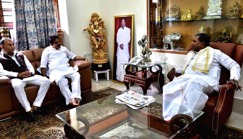 Newly appointed Congress Karnataka In-Charge K. C. Venugopal calls on Karnataka Chief Minister Siddaramaiah at his residence in Bengaluru, on May 10, 2017. - Siddaramaiah