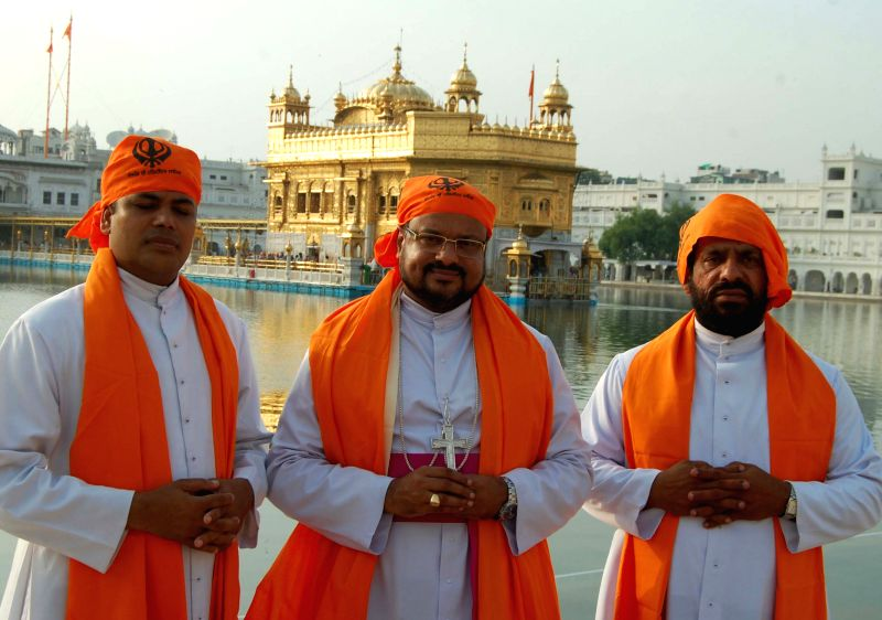:Newly appointed DIOCESE of Jalandhar, Bishop Franco Mulakkal paying obeisance  at Golden Temple in Amritsar on August 7, 2013. (Photo: IANS).