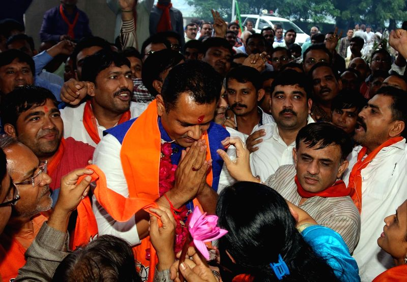 Newly appointed Gujarat BJP Chief Jitu Vaghani being greeted by party workers in Gandhinagar on Aug 10, 2016.