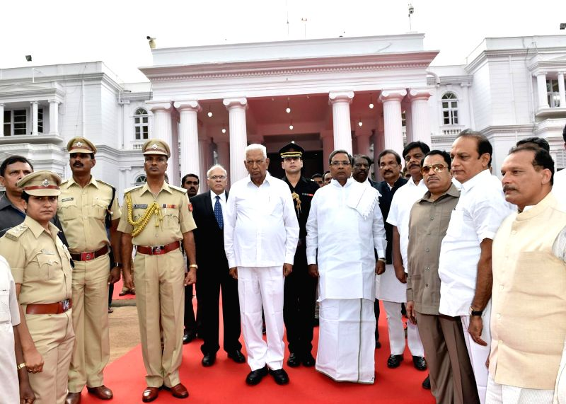 Newly appointed Karnataka Governor Vajubhai Rudabhai Vala with Karnataka Chief Minister Siddaramaiah and others during former's swearing-in ceremony as the Governor of the state at Raj Bhavan in ... - Siddaramaiah