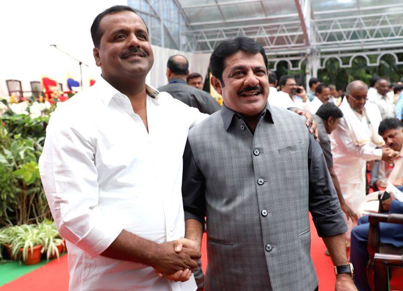 Newly appointed Karnataka Ministers BZ Zameer Ahamed Khan and U. T. Khader during their swearing-in ceremony at Raj Bhawan in Bengaluru on June 6, 2018. - B and Zameer Ahamed Khan