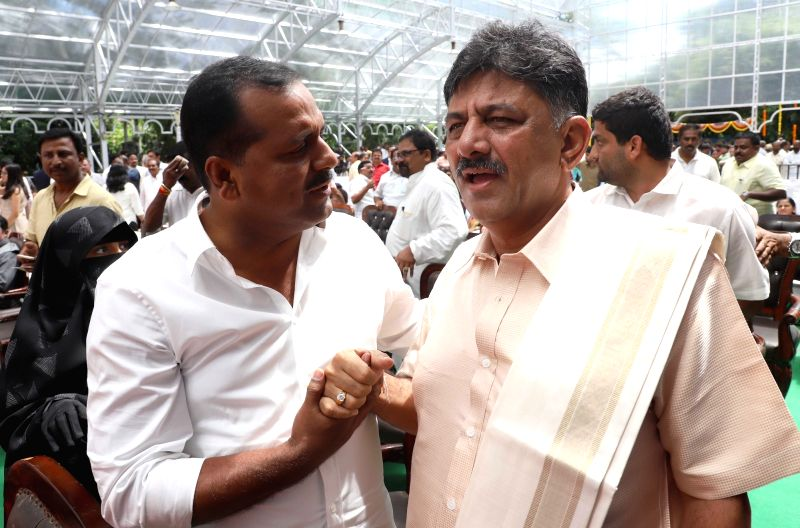 Newly appointed Karnataka Ministers D. K. Shivakumar and U. T. Khader during their swearing-in ceremony at Raj Bhawan in Bengaluru on June 6, 2018. - D. K. Shivakumar and U. T. Khader