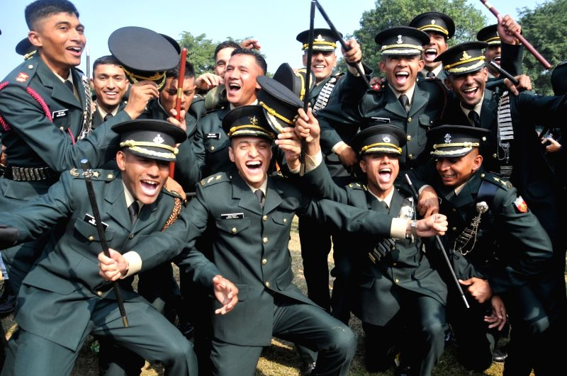 Newly commissioned officers celebrate after their passing-out parade at Indian Military Academy, Dehradun on Dec 12, 2015.