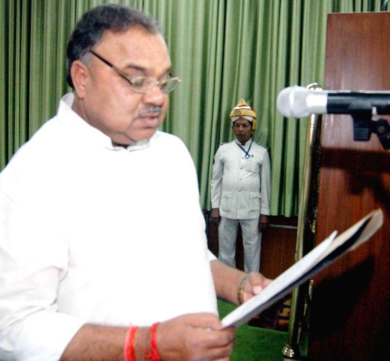 Newly elected BJP legislator Ram Narayan Mandal takes oath of office in Patna on Sept 4, 2014.