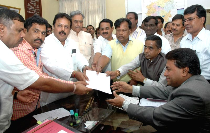 Newly elected JD(S) legislator Puttanna files his nominations for the post of Deputy Chairman of Karnataka Legislative Council in Vidhan Soudha in Bangalore on July 14, 2014.