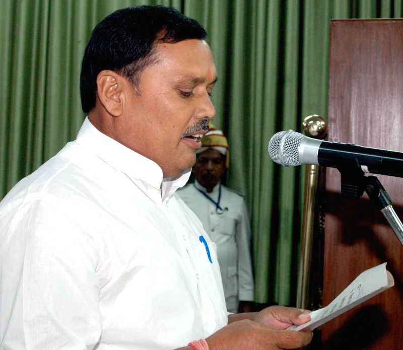 Newly elected RJD legislator Ram Avtar Paswan takes oath of office in Patna on Sept 4, 2014.