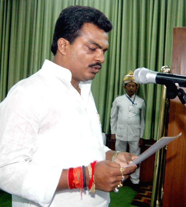 Newly elected RJD legislator Randhir Kumar Singh  takes oath of office in Patna on Sept 4, 2014. - Randhir Kumar Singh