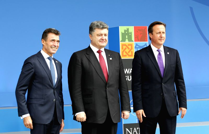 The NATO Secretary General Anders Fogh Rasmussen (L), Ukrainian President Petro Poroshenko (C) and British Prime Minister David Cameron pose for a photo at the NATO - David Cameron